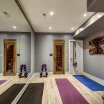 Small-basement-gym-room-with-huge-wall-mirrors-basement-renovations-mississauga