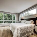 amazing-bedroom-with-reflective-build-in-cabinets-and-gray-wall-painting-custom-built-homes-toronto