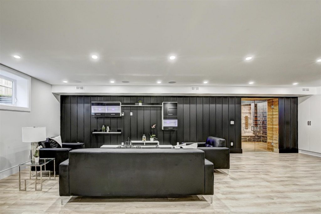 basement-family-room-with-amazing-baseboard-trim-and-wine-storage-space-basement-renovation-hamilton