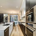 build-in-appliances-and-white-counter-top-kitchen-renovation-markham