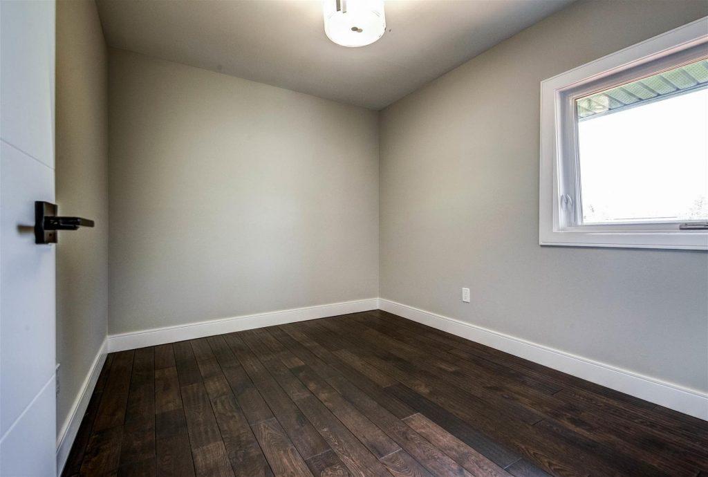 custom-basement-bedroom-with-baseboard-trim-basement-renovations-toronto-and-GTA