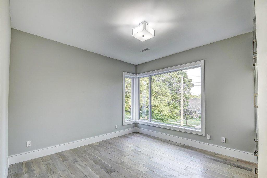 custom-bedroom-with-bow-window-and-baseboard-trim-interior-design-company-toronto