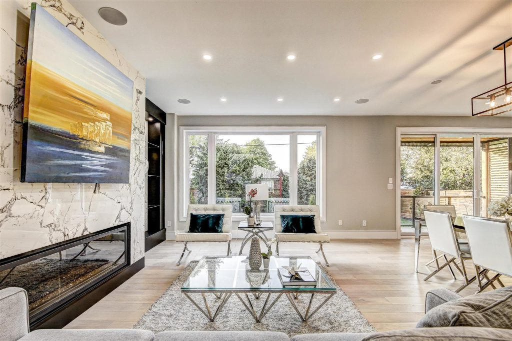 custom-family-room-with-build-in-fireplace-and-wooden-floor-home-builders-toronto