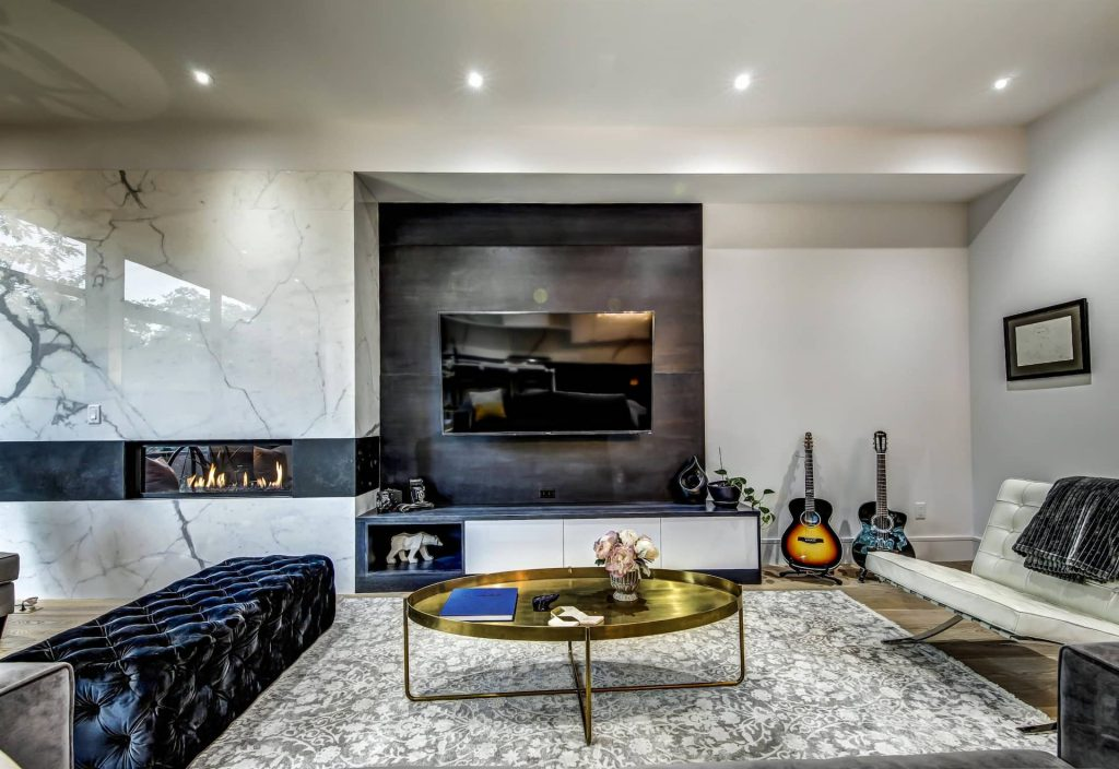 Amazing Family Room with Marble Wall Decor and Build in Fireplace - Home Remodeling Oakville