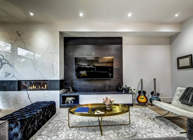 Amazing Family Room with Marble Wall Decor and Build in Fireplace - Home Remodeling