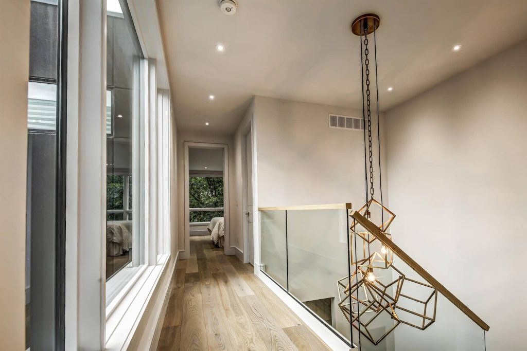 custom-home-hallway-with-glass-railings-and-stretch-ceiling-interior-designer-oakville