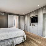 custom-master-bedroom-with-build-in-cabinets-and-custom-interior-doors-modern-custom-homes
