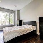 custom-master-bedroom-with-potlights-and-dark-wood-floor-home-renovation-contractors-toronto