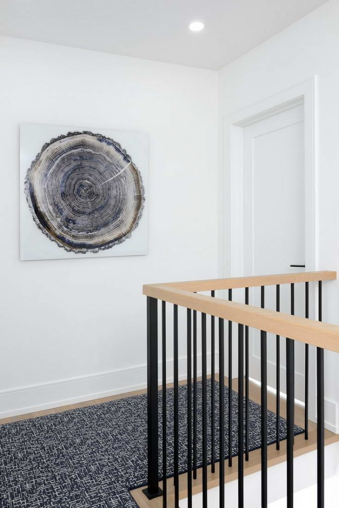 custom staircase with wooden railings - interior designers