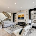 family-room-with-marble-wall-decor-and-build-in-fireplace-custom-home-by-nicks-developments