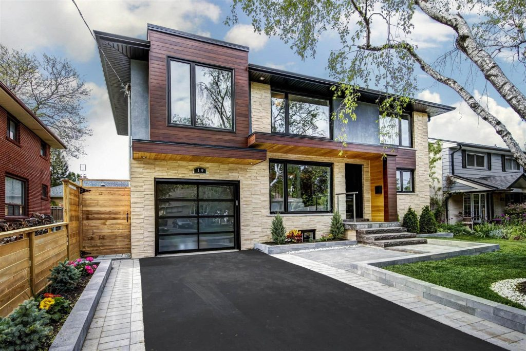 Modern Home with Stone Siding and Wooden Exterior Trim - Home Renovations Toronto