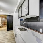 kitchen-with-glass-kitchen-cabinets-and-gray-splash-wall-kitchen-renovation-by-nicks-developments