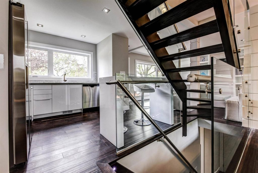 luxury-interior-stairs-with-glass-railings-and-wooden-stairs
