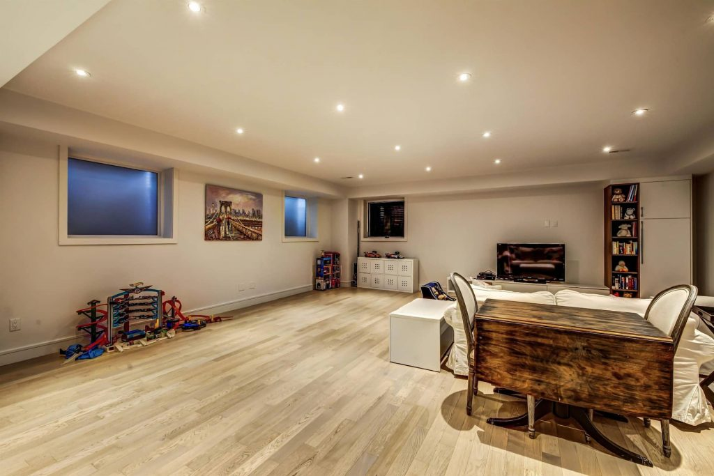 luxury-open-space-basement-with-baseboard-trim-and-potlights-basement-renovations-hamilton
