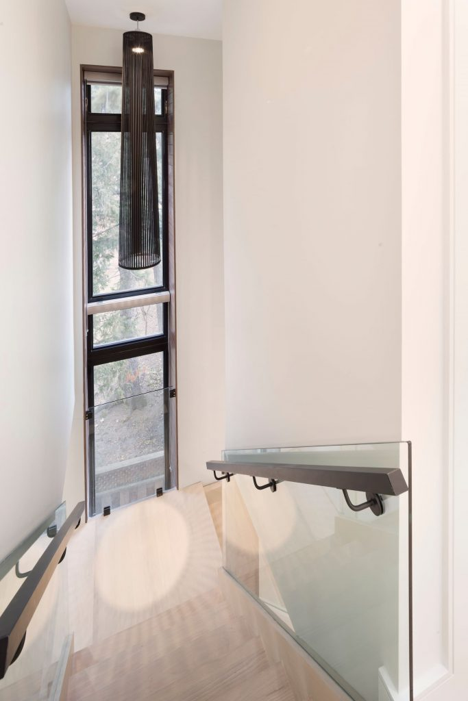luxury-staircase-with-wooden-stairs-and-glass-railings-custom-homes-toronto