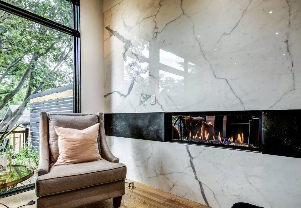 marble-wall-decor-and-build-in-fireplace-in-custom-family-room-home-renovation-contractors