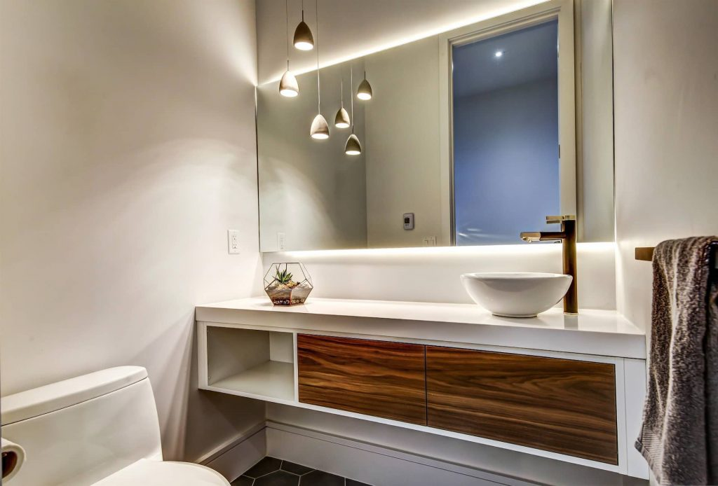 modern-bathroom-with-backlit-mirror-and-custom-vanity-bathroom-renovation-company