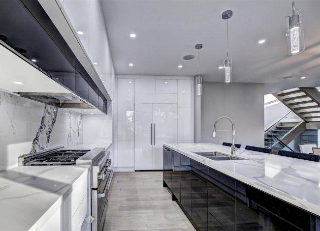 Reflective White Kitchen Cabinets in Custom Kitchen - Kitchen Designers