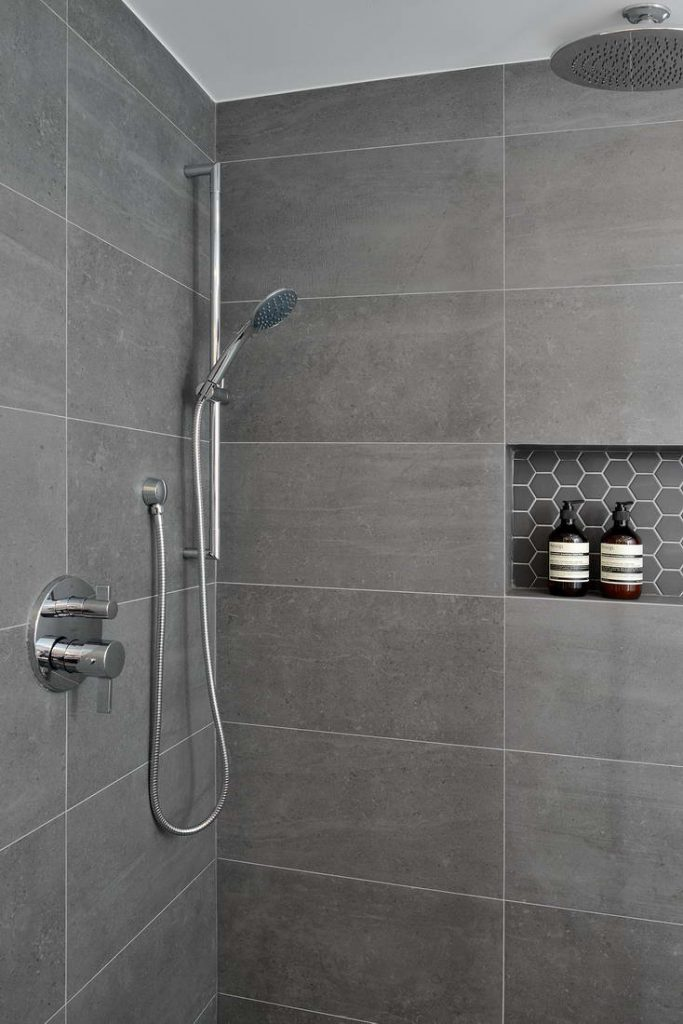 modern walk in shower with build in storage space - home builders toronto