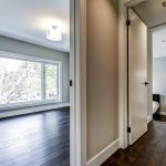 second-floor-bedroom-with-baseboard-trim-house-renovation-by-nikes-developments