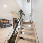 second-floor-staircase-with-glass-railings-and-green-backlit-ceiling-interior-designers-toronto-and-GTA