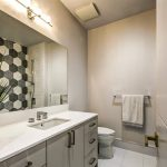 small-bathroom-renovations-with-custom-doors-and-vanity