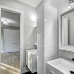 small-bathroom-renovations-with-high-gloss-cabinets-and-double-vanity